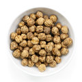 Roasted chickpeas isolated in small bowl on white delicious healthy snacking Stock Images