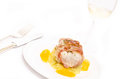 Roasted cod with pancetta bacon and a glass of white wine Royalty Free Stock Images