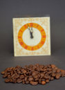 Roasted cofee and vintage clock picture of a Royalty Free Stock Images