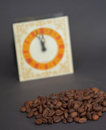Roasted cofee and vintage clock picture of a Royalty Free Stock Photography