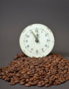Roasted cofee and vintage clock picture of a Stock Photo