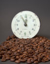 Roasted cofee and vintage clock picture of a Stock Image