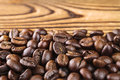 Roasted coffee bean arabica on wooden table, close-up, selective focus Royalty Free Stock Photo