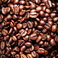 Roasted coffee beans background texture arabic roasting coffee ingredient of hot beverage brown for and Stock Photo