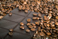 Roasted coffee beans with chocolate can be used as a background Royalty Free Stock Photo