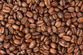 Roasted coffee beans close up background Stock Images