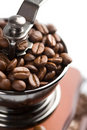 Roasted coffee beans in grinder isolated Royalty Free Stock Photos