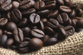 Roasted coffee beans a juta bag with Stock Images