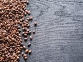 Roasted coffee beans on the old wooden background. Top view. Royalty Free Stock Photo