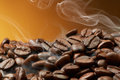 Roasted coffee beans pile of with smoke Royalty Free Stock Images