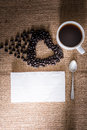 Roasted coffee beans in the shape of a heart and coffee cup, Tis Royalty Free Stock Photo