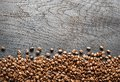 Roasted coffee beans on wooden table. Top view. Royalty Free Stock Photo
