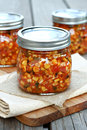 Roasted corn salsa in glass jars Stock Photo