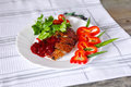 Roasted duck fillet with berry sauce and vegetables on a wood table Stock Image
