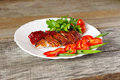 Roasted duck fillet with berry sauce and vegetables on a wood table Royalty Free Stock Photography