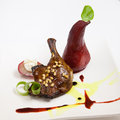 Roasted duck leg with pear in wine Stock Photos