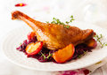 Roasted duck leg with red cabbage and apples for christmas Royalty Free Stock Photo