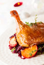 Roasted duck leg with red cabbage and apples for christmas Royalty Free Stock Images