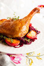 Roasted duck leg with red cabbage and apples for christmas Stock Photo