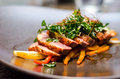 Roasted duck with pak choy closeup of breast vegetables and crunchy Royalty Free Stock Photo