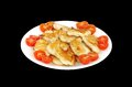 Roasted fish in oven and garnish with cherry tomato isolated on black Royalty Free Stock Photo