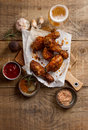 Roasted griiled chicken drumstick on cutting board with sauce and spices selective focus Royalty Free Stock Photography