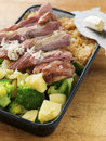 Roasted ham with potatoes broccoli and horseradish Stock Photo