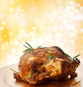 Roasted holiday whole chicken on abstract yellow light background Stock Image