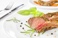 Roasted lamb rib chops on a plate. Royalty Free Stock Photo