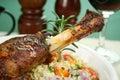 Roasted lamb shank tomato butternut pumpkin parsley couscous Royalty Free Stock Photos