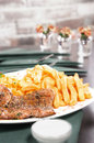 Roasted meat served with french fries selective focus Royalty Free Stock Photography