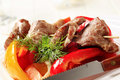 Roasted meat on skewer and baked vegetable Stock Photo