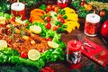 Roasted meats. Thanksgiving table served with turkey, decorated with bright Christmas decor and candles. Christmas dinner Royalty Free Stock Photo