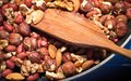 Roasted mixed nuts on frying pan Royalty Free Stock Photos