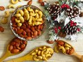 Roasted Natural Almond Nuts Badam and Cashew in a porcelain bowl and Christmas home decoration. Royalty Free Stock Photo