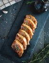 Roasted pork chops with fresh rosemary on dark background, top view Royalty Free Stock Photo