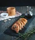 Roasted pork chops with fresh rosemary on dark background Royalty Free Stock Photo