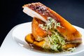 Roasted pork with mashed pumpkin close up of grilled ribs sweet Royalty Free Stock Images