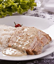 Roasted pork with mustard sauce accompanied with rice Royalty Free Stock Photo