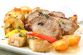 Roasted pork with potatoes on white top isolated Royalty Free Stock Photo