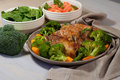 Roasted pork ribs on plate with broccoli Royalty Free Stock Photo
