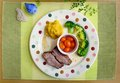 Roasted pork ribs and vegetable meal Royalty Free Stock Photo