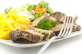 Roasted pork and scalloped potatoes rubbed in pepper with au gratin a healthy salad Royalty Free Stock Photo