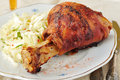 Roasted pork shank with fresh cabbage salad selective focus Royalty Free Stock Image