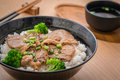 Roasted pork with stir fried broccoli and japanese rice in bowl Royalty Free Stock Photo