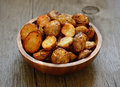 Roasted potato in bowl on wooden table Royalty Free Stock Image