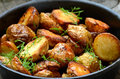 Roasted potato in a frying pan close up view Stock Photography