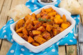 Roasted pumpkin with herbs and tomato puree Royalty Free Stock Photo