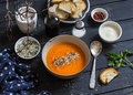 Roasted pumpkin soup in a ceramic bowl on dark wooden surface Royalty Free Stock Photography