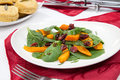 Roasted pumpkin and spinach salad sage biscuits carved spiced ham appetizers with christmas ornaments Stock Image